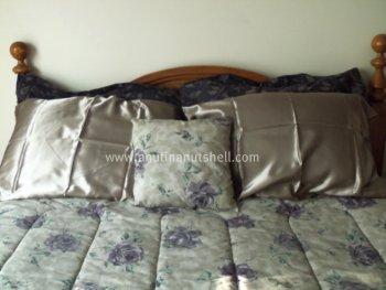 satin sheets made bed