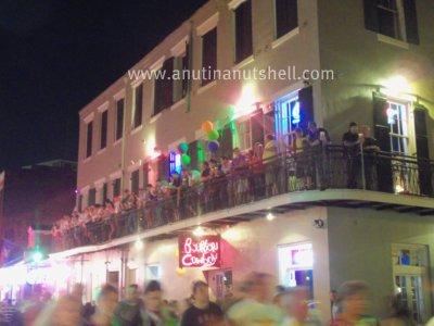 Bourbon Street people on balcony
