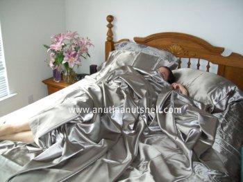 sleeping on satin sheets