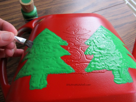 paint Christmas trees on watering can