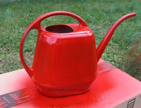 spray painting a watering can