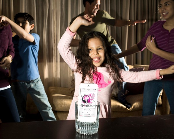 family travel hacks - put your phone inside an empty glass to amplify the sound and have a dance party
