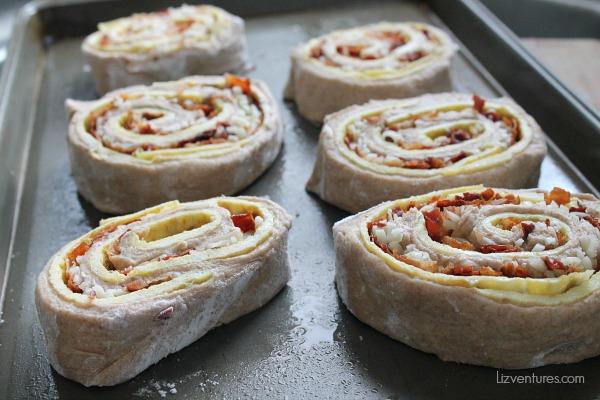 flatbread breakfast pinwheels on cookie sheet