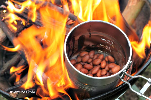 cooking beans over the fire with Stanley camp cook set