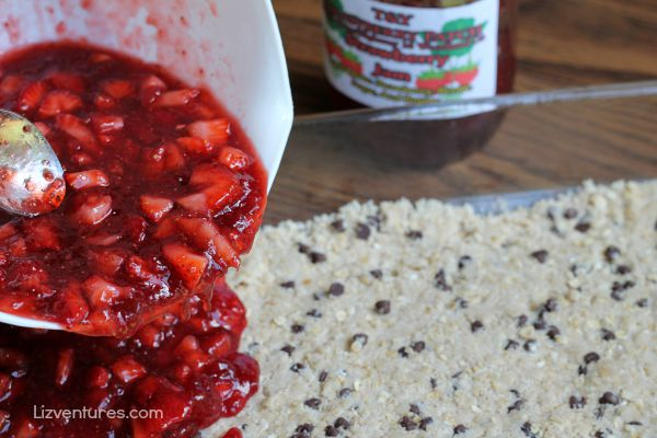 spread strawberry preserve mixture over crumble crust